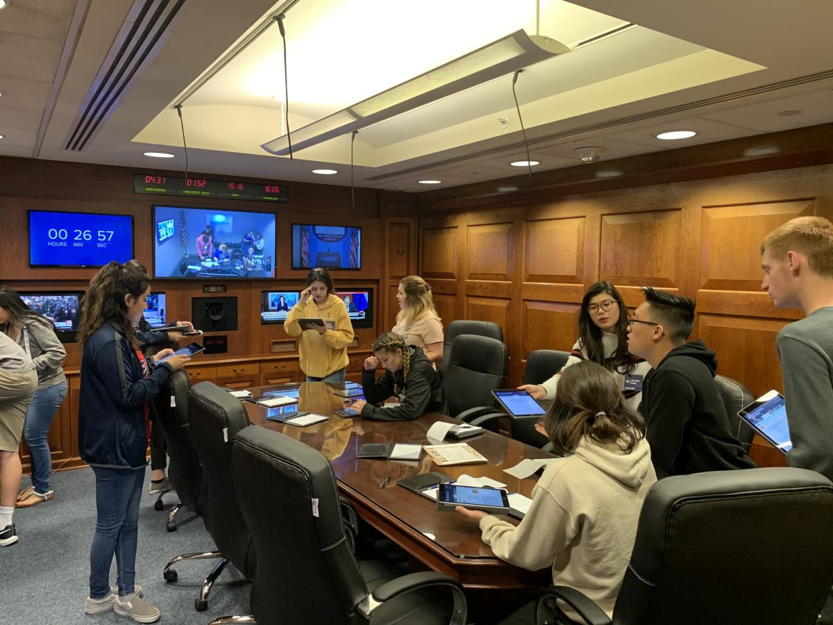 Students playing Situation Room Experience