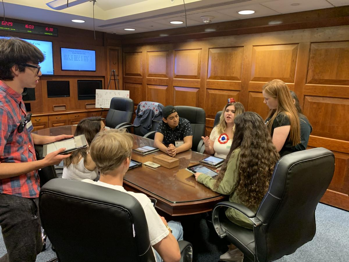 Students playing the Situation Room Experience: Washington's Cabinet